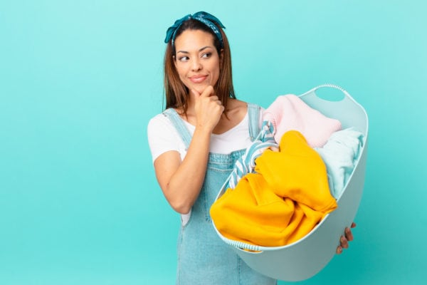 Image of woman considering a dry cleaning or laundry service